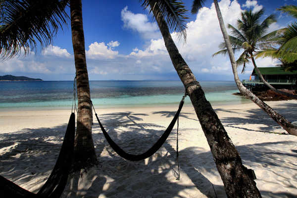Try sleeping In A Hammock at Rawa Island